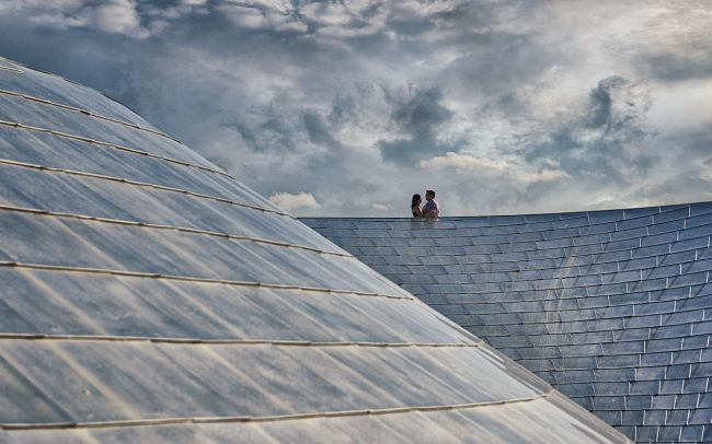 Engaged couple on BP Bridge at Millennium Park