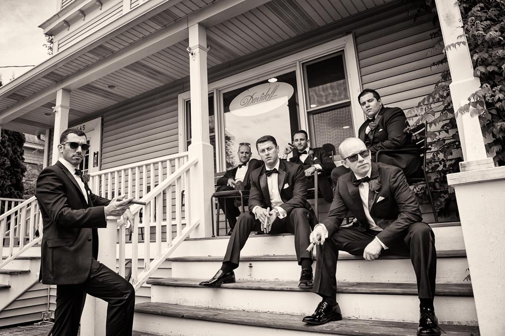 Groomsmen with cigars dramatic portrait