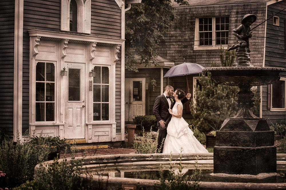 Kissing under umbrella in Long Grove