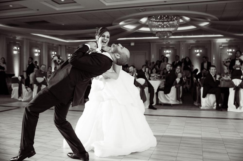 Bride dipping groom during first dance