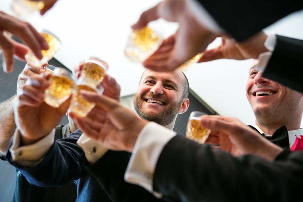 groomsmen celebrating toast