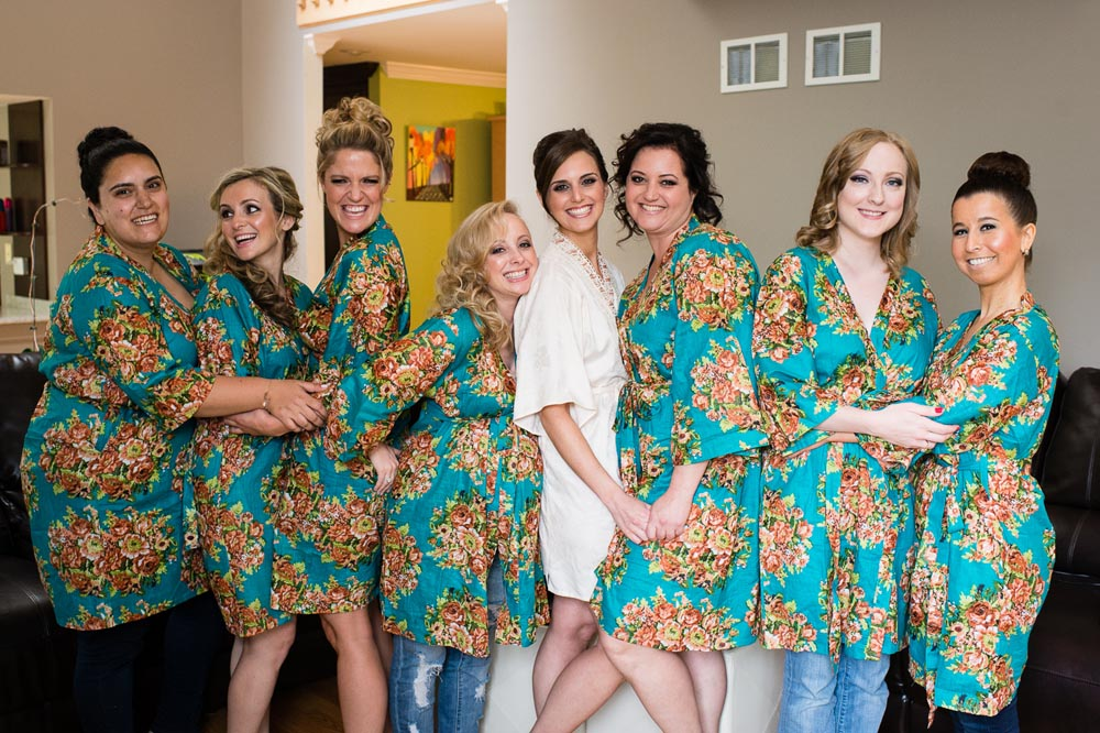 bridesmaids custom bathrobe while hugging