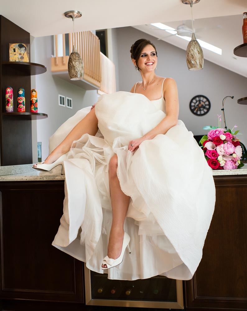 bride showing leg while sitting on counter