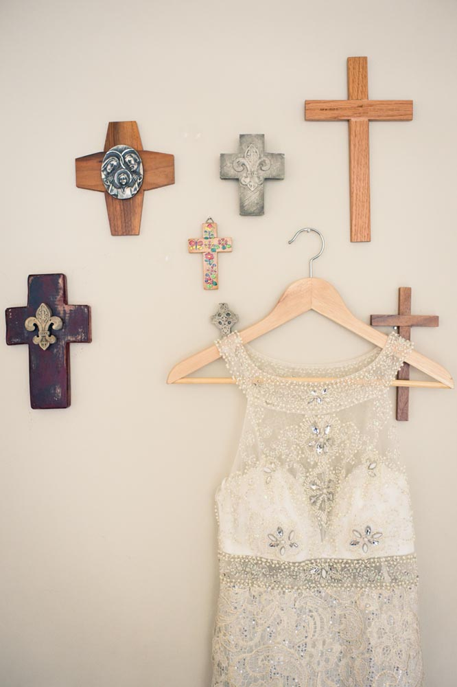 Wedding dress with crosses on the wall