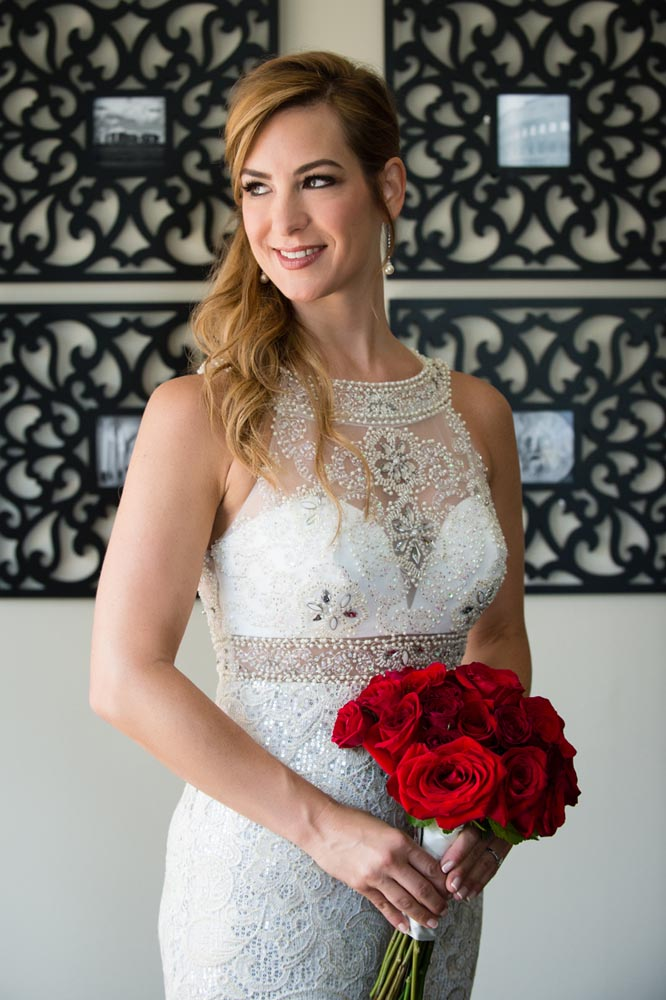 Bride portrait at home with red bouquet
