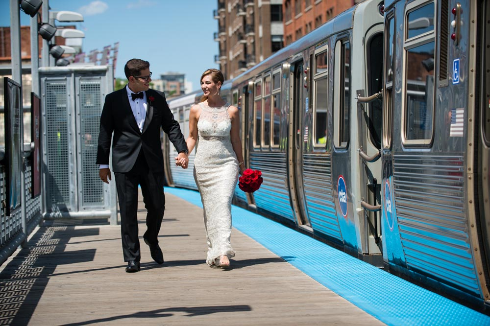Bride and groom walking on train platform
