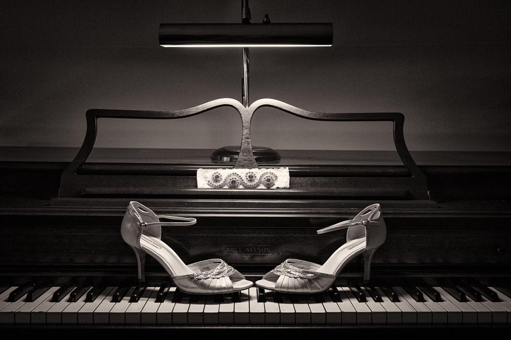 Wedding shoes on piano
