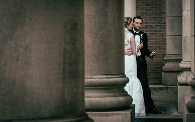 Bride and groom near The Drake Hotel in Chicago with a pocket watch