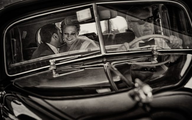 Wedding couple in vintage car
