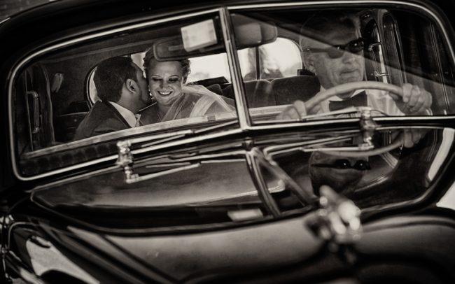 Wedding couple in vintage car
