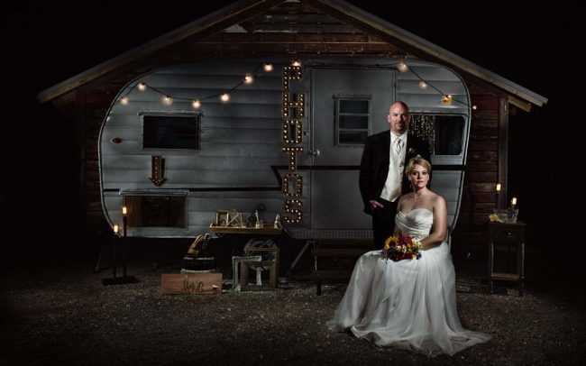 Wedding portrait at Heritage Prairie Farm in front of Jazi Photo Booth