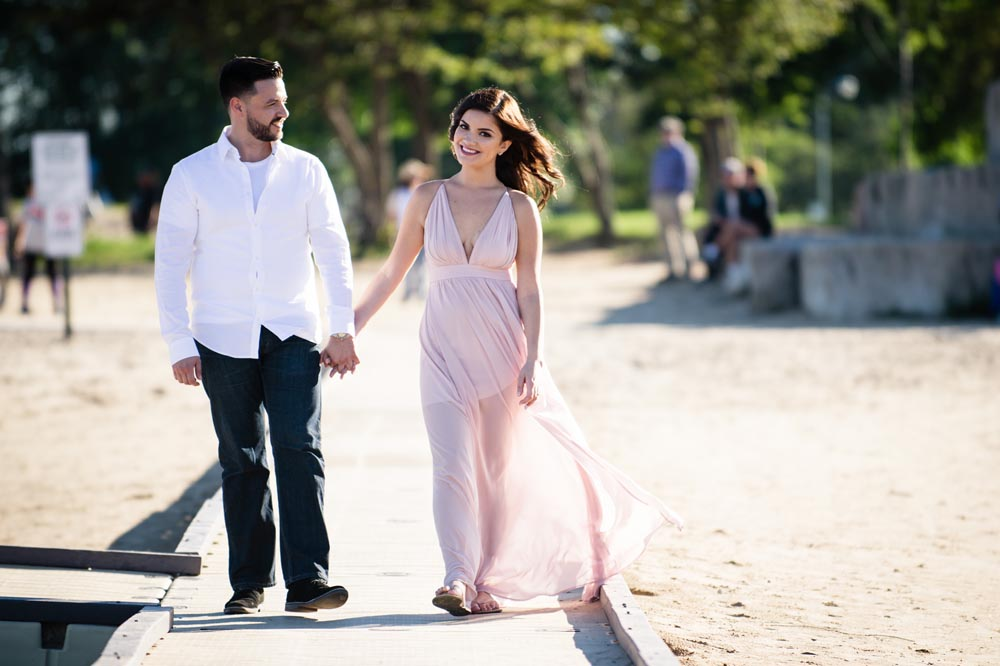 Montrose Harbor engagement walking and smiling