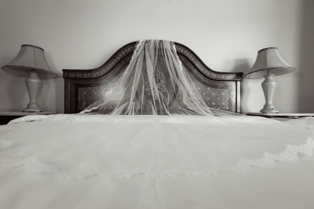 Cathedral veil laid out on bed