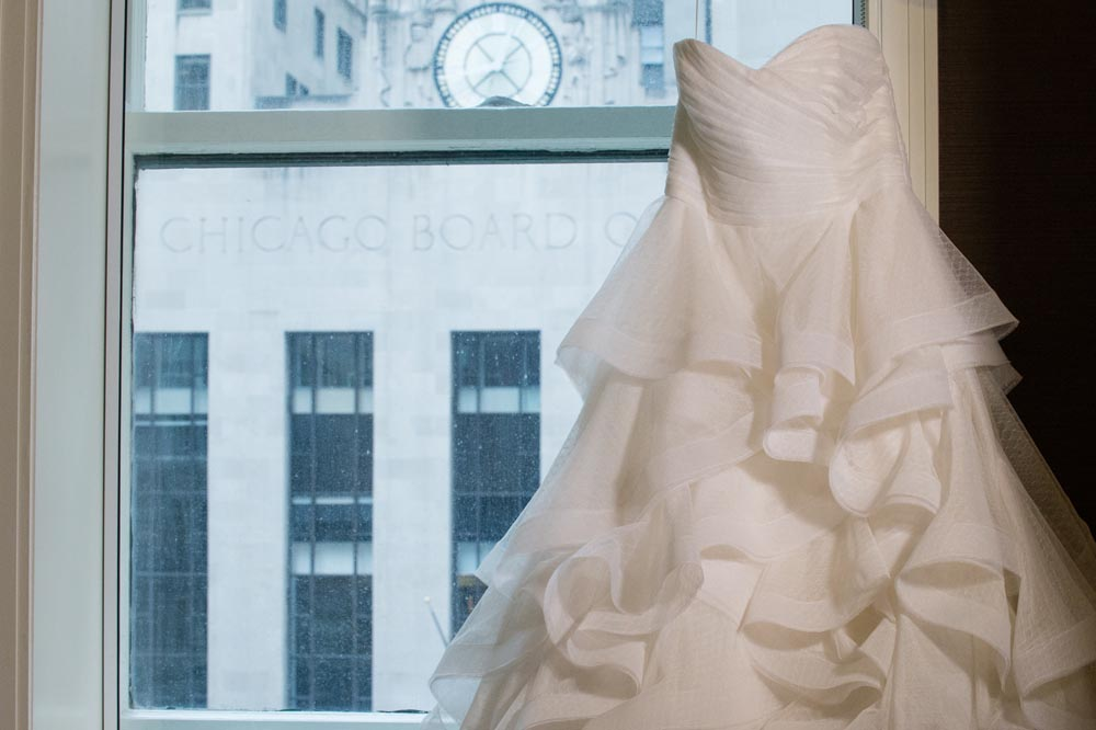 Wedding dress at jw marriott chicago with a view of Chicago Board of Trade