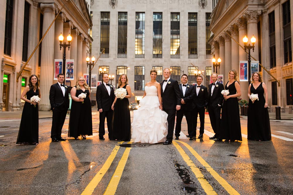 Financial district Chicago wedding party in front of Chicago Board of Trade