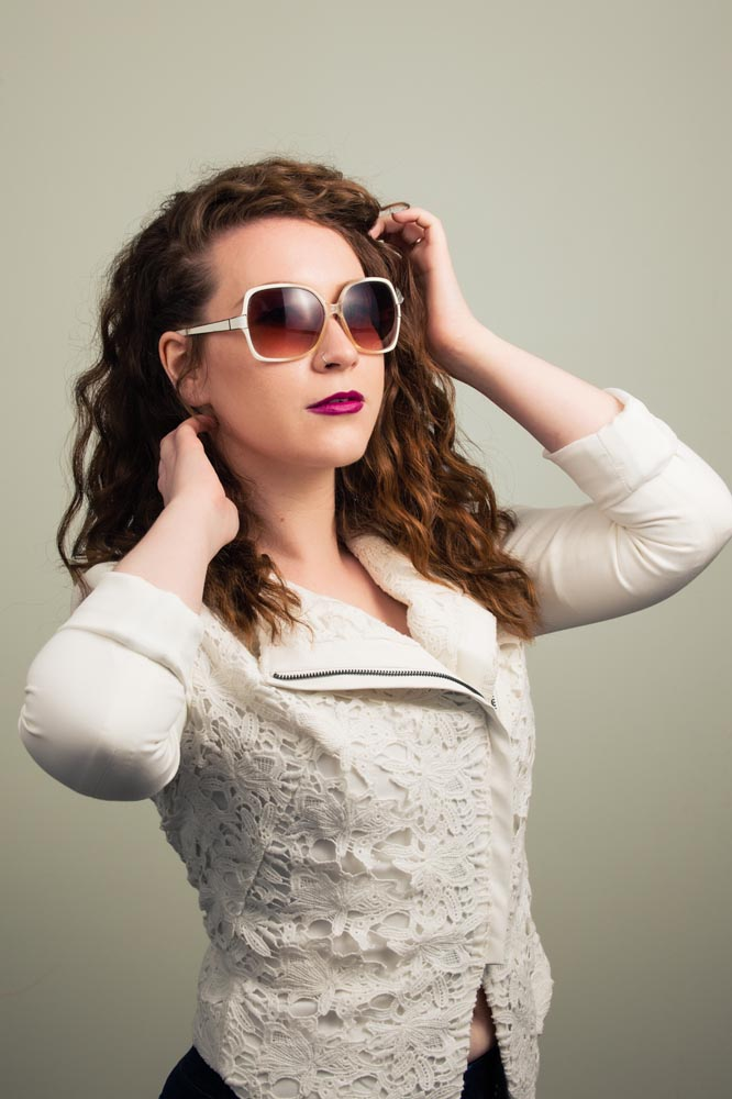 Fashion portrait with sunglasses and white jacket