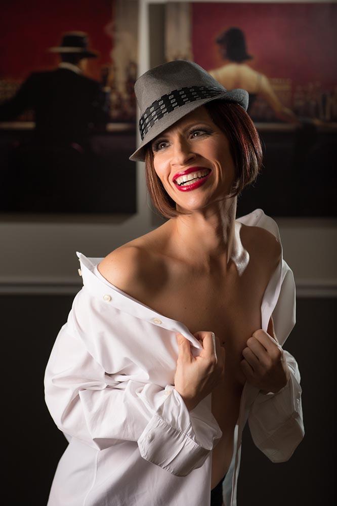 Smiling boudoir with his white dress shirt