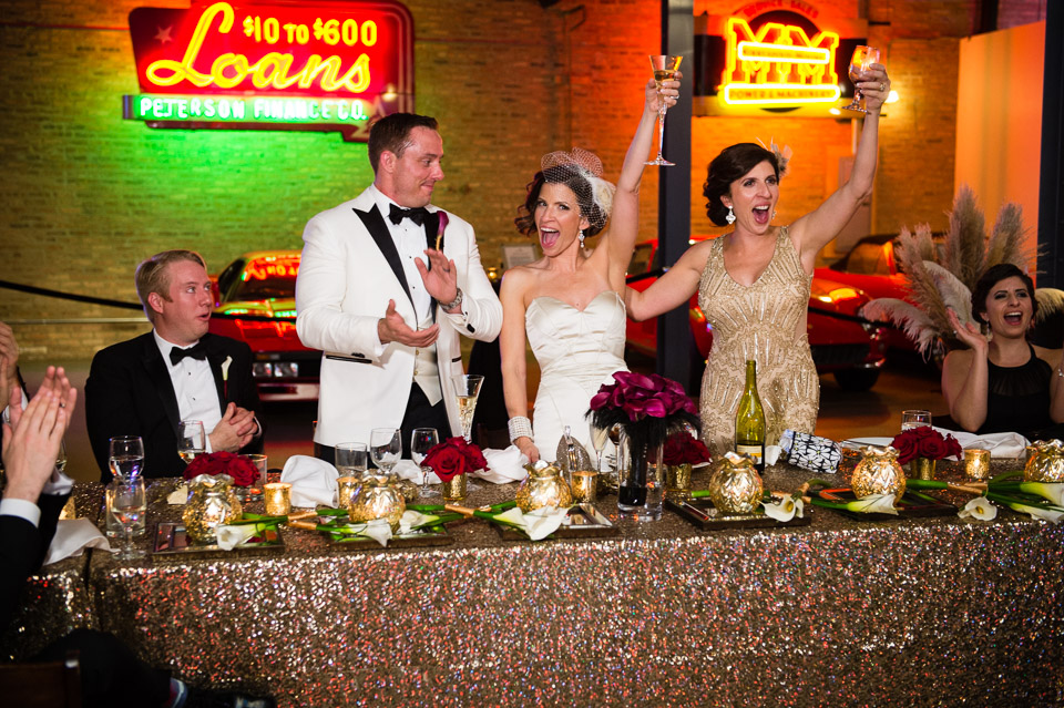Wedding toast celebration with neon signs in the background
