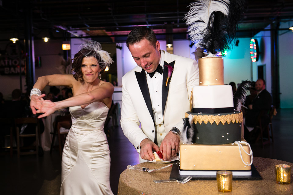 Bride and groom getting ready to cut the cake at Ravenswood Event Center