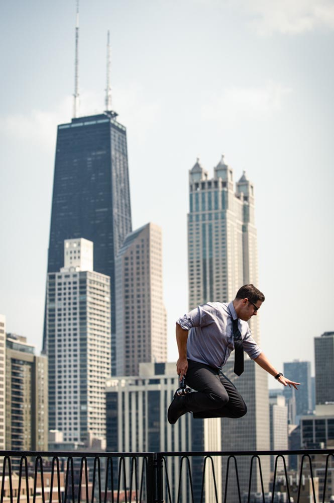 Jumping from building with Chicago skyline