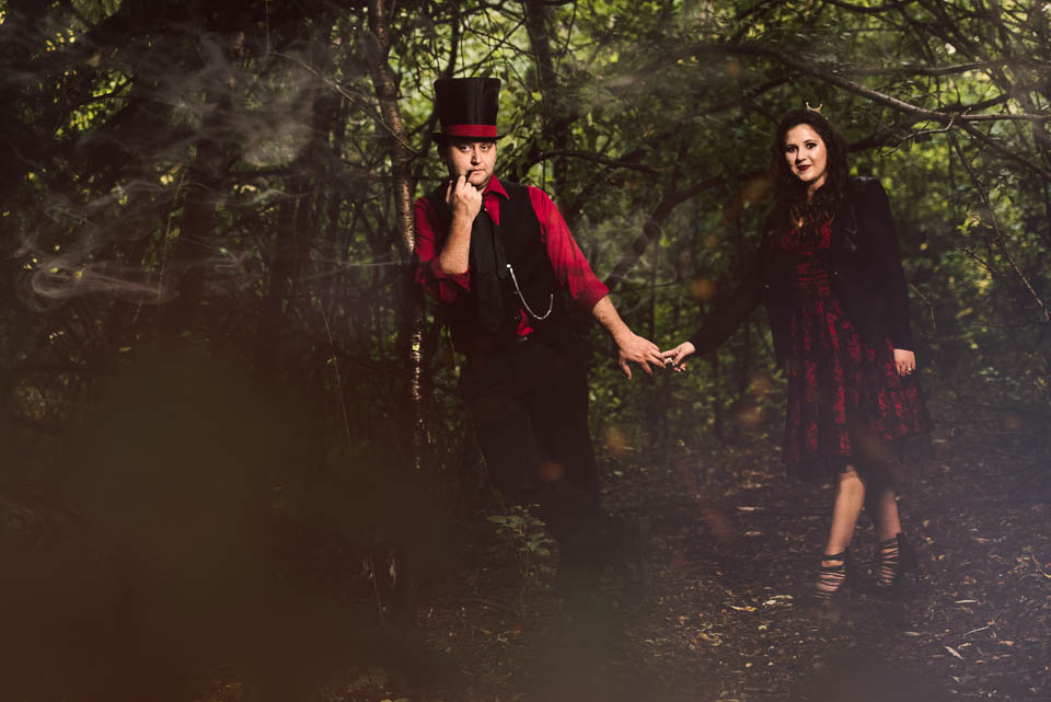 Queen of Hearts and Mad Hatter in the woods