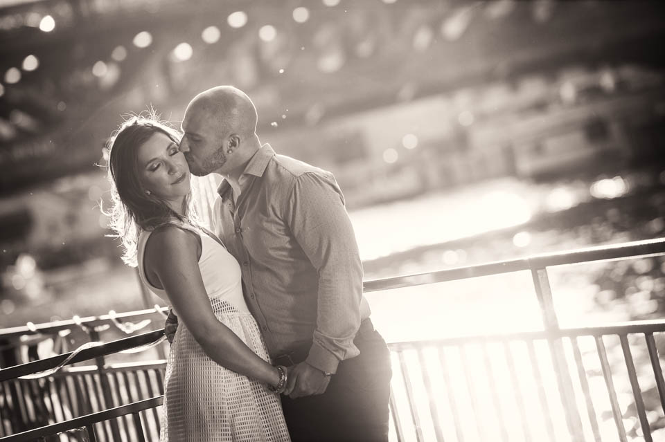 Sweet kiss during engagement session Riverwalk Chicago