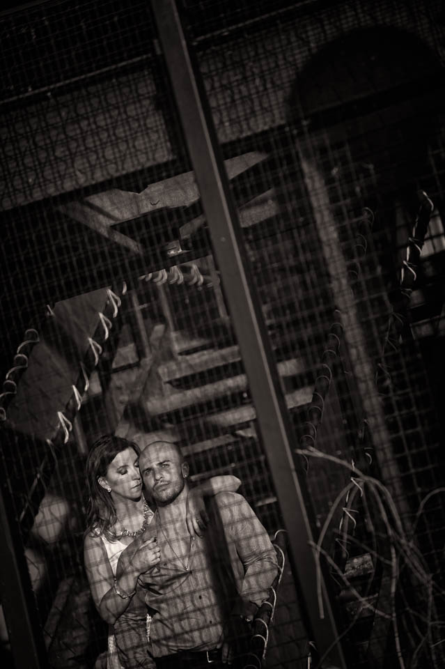 Dramatic engagement portrait on metal stairs on the Riverwalk