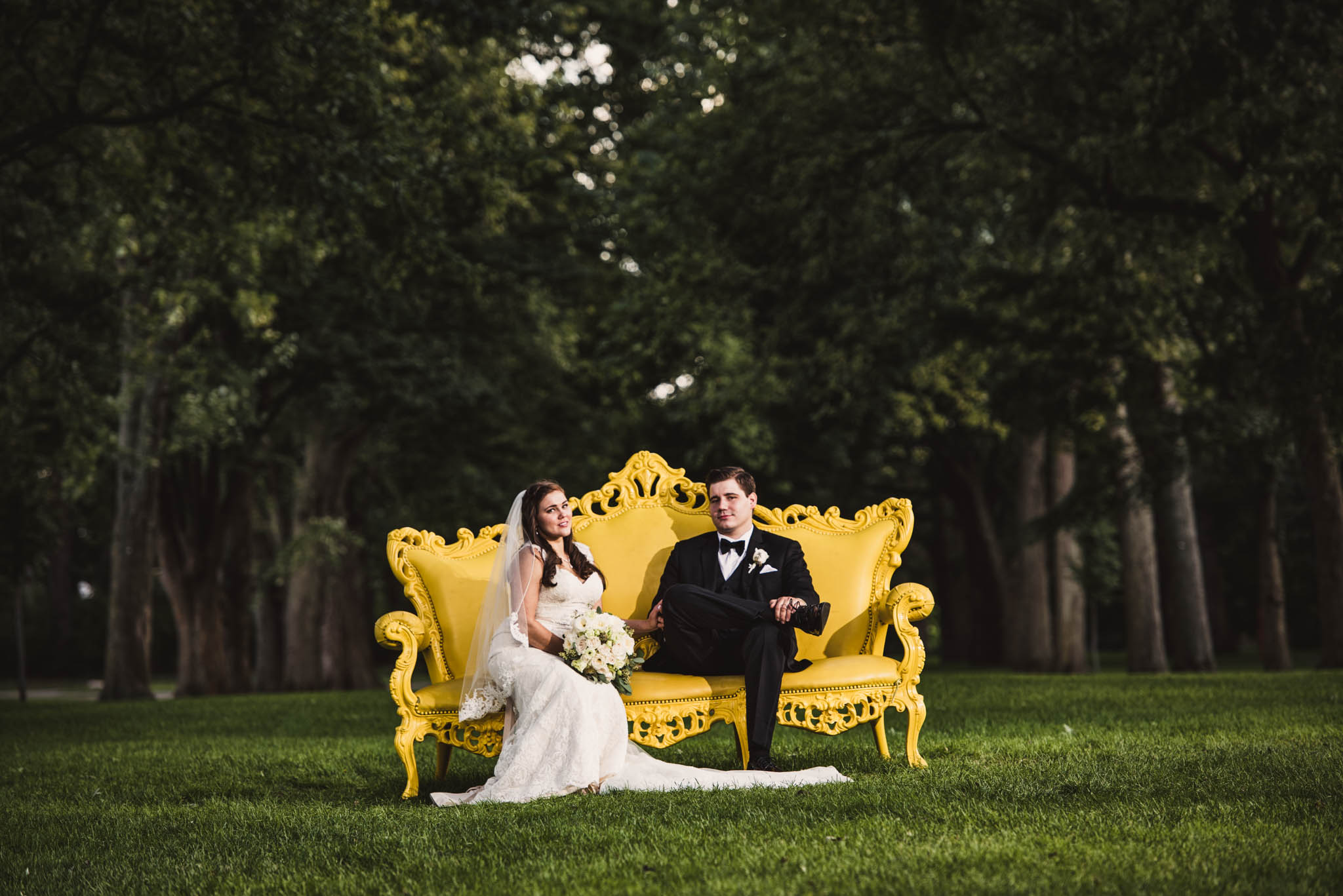 Fine art wedding portrait on a large yellow bench at Cantigny Park