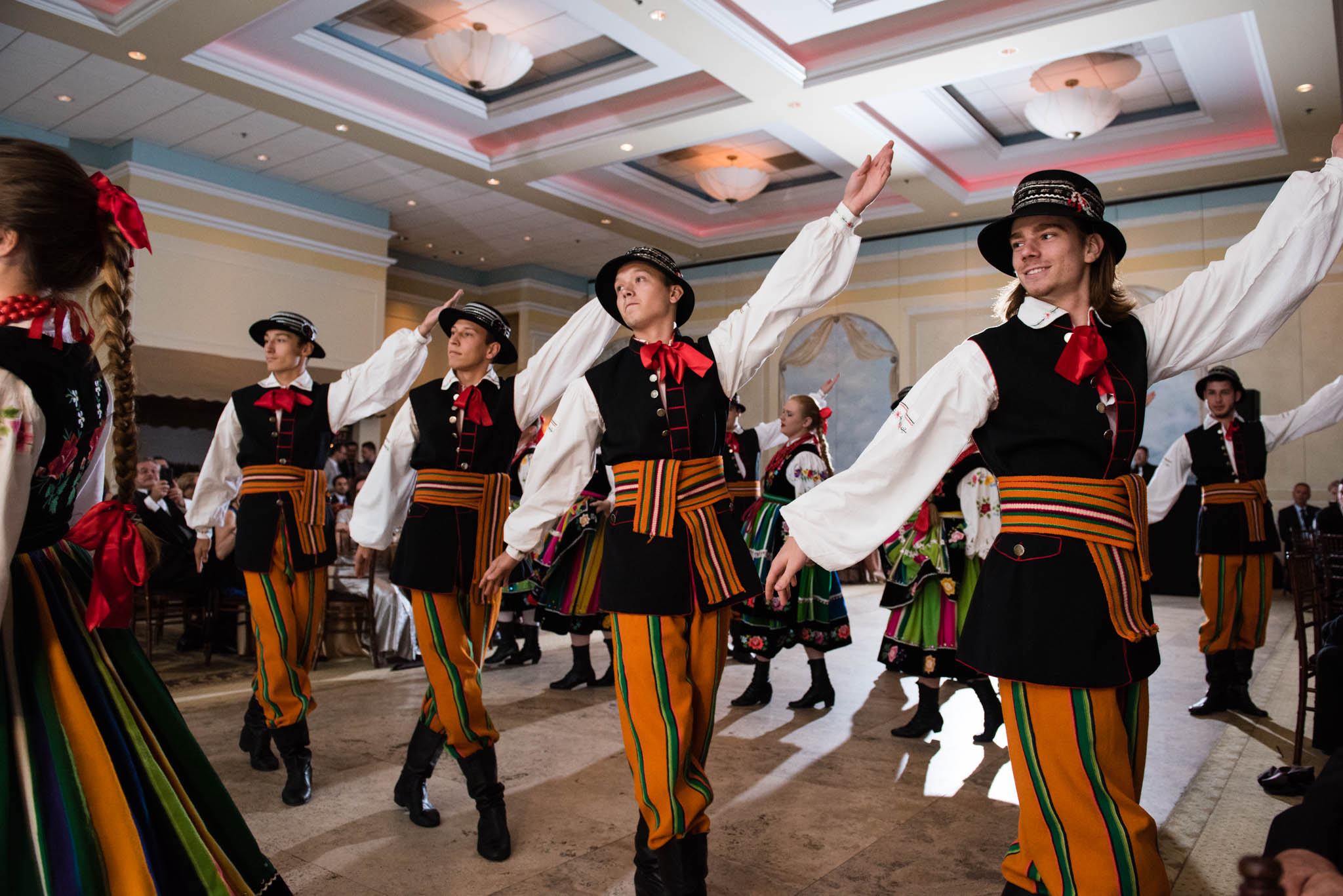 Traditional folk Polish dance group performing at a wedding