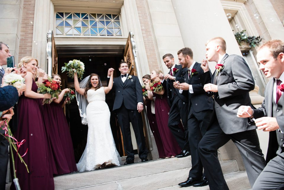 Chicago wedding bubbles exit at Holy Trinity Roman Catholic Church