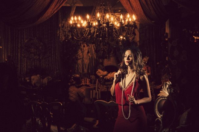 Modern glamour portrait in red dress at Boutique Photo Loft