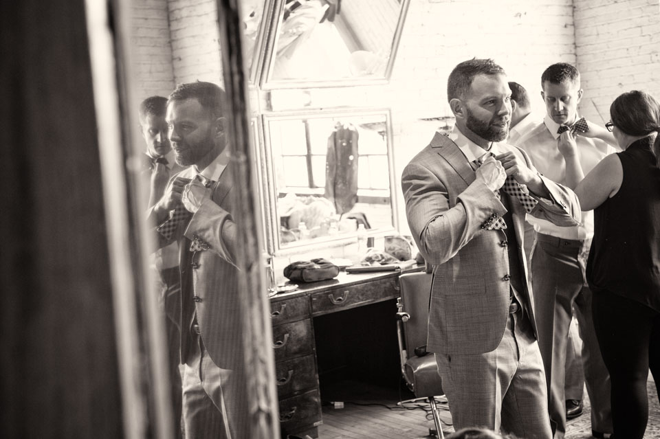 Groom getting ready at Salvage One