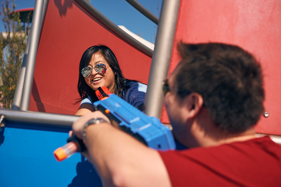 Squirt gun fight at Maggie Daley Park during engagement session