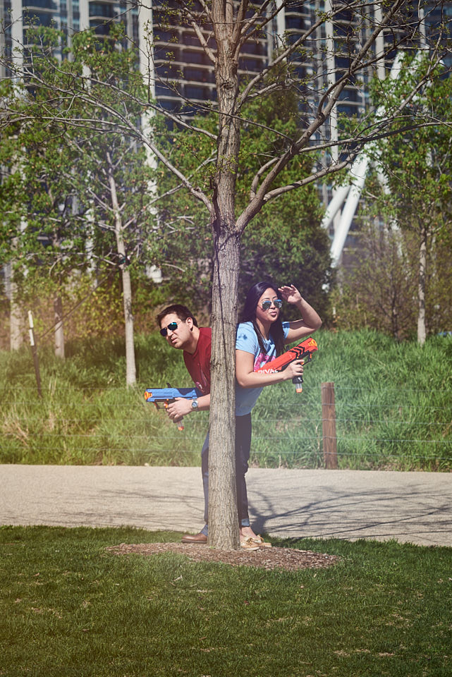 Funny engagement session behind tree