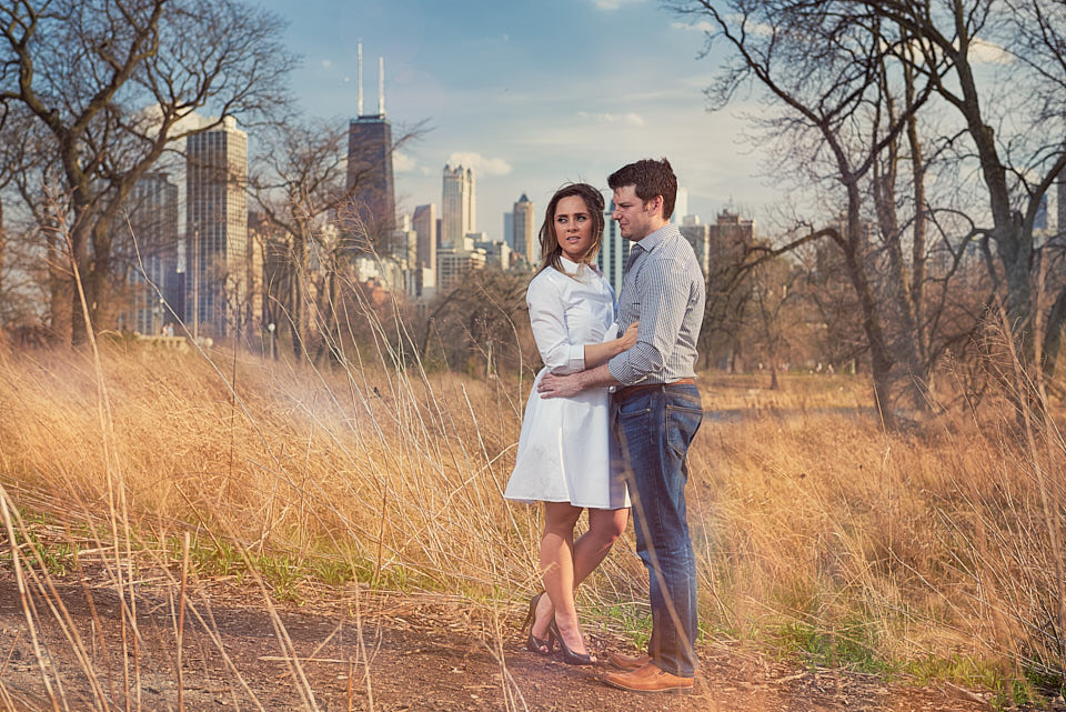 Engagement portrait with city skyline at South Pond