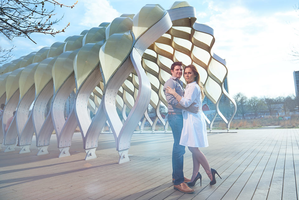 Engagement portrait in front of Studio Gang honeycomb structure at South Pond