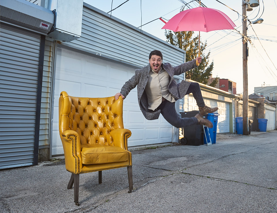 Chicago Fire Yuri Sardarov dancing with yellow chair and red umbrella