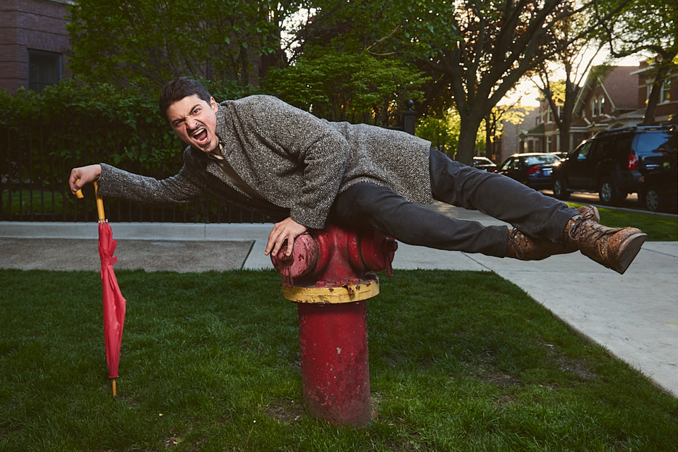 Yuri Sardarov laying on fire hydrant