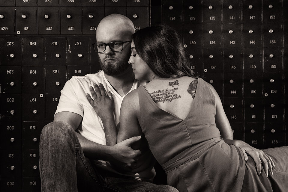 Engagement couple with lock box backdrop