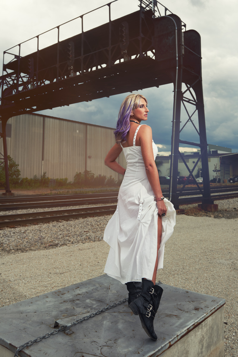 Rail yard glamour portrait in white dress