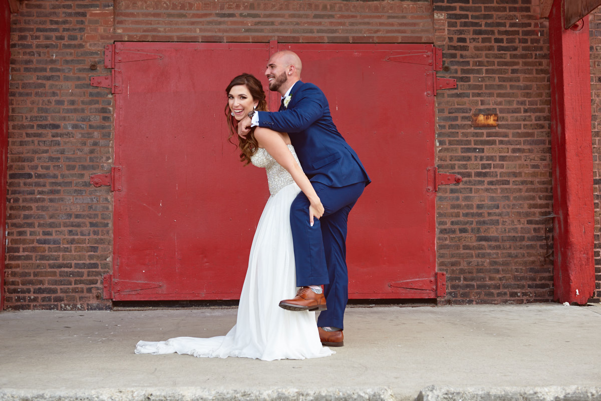 Groom getting a piggy back ride
