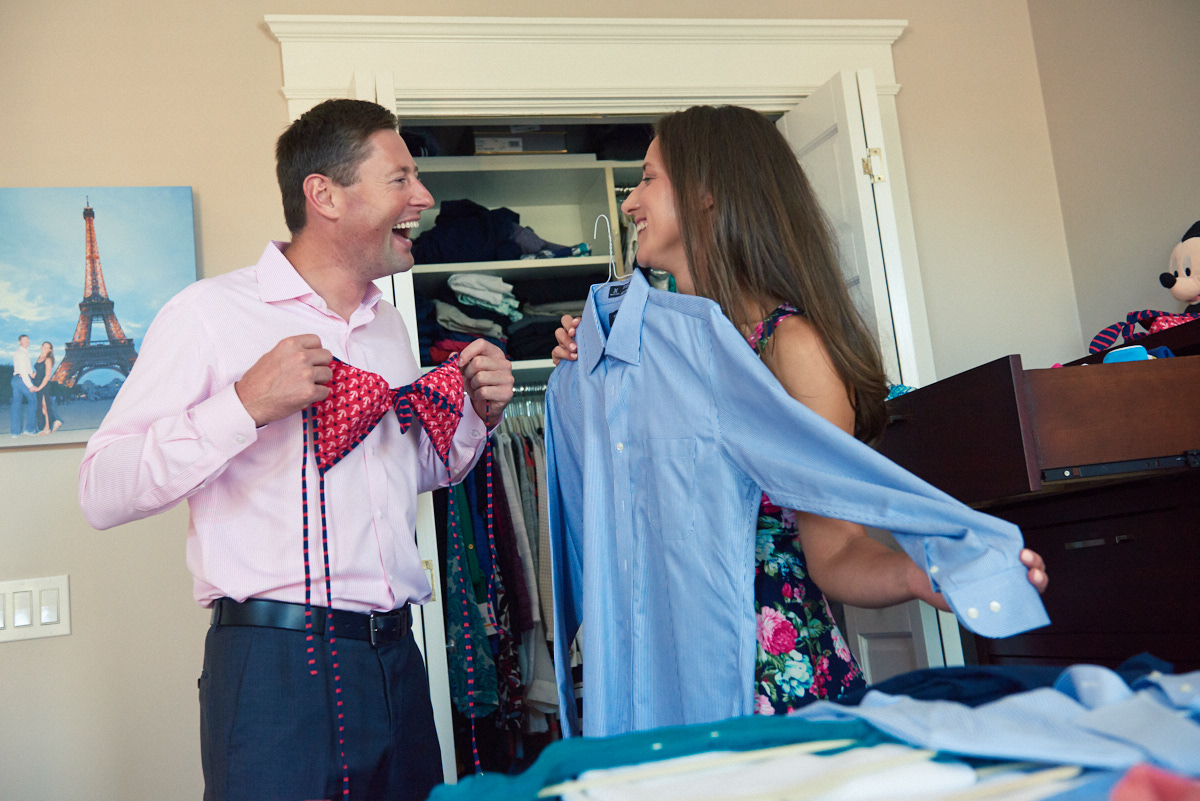 Funny bride and groom packing for engagement shoot