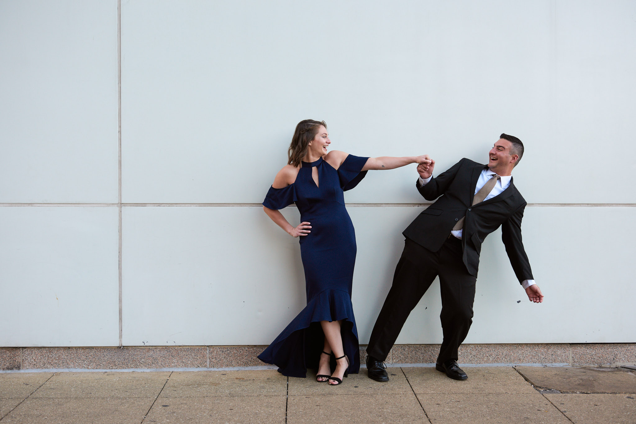 Dancing engagement in front of white wall