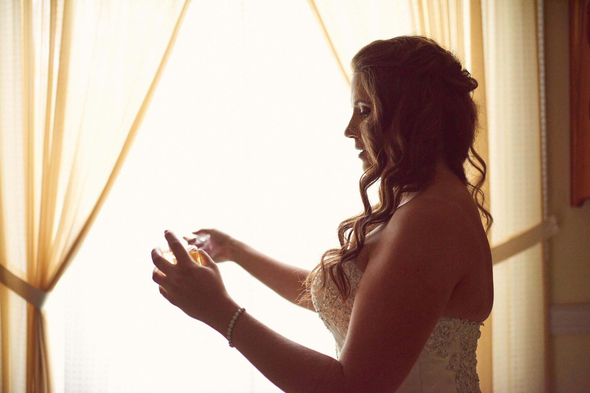 Bride spraying Chanel No5