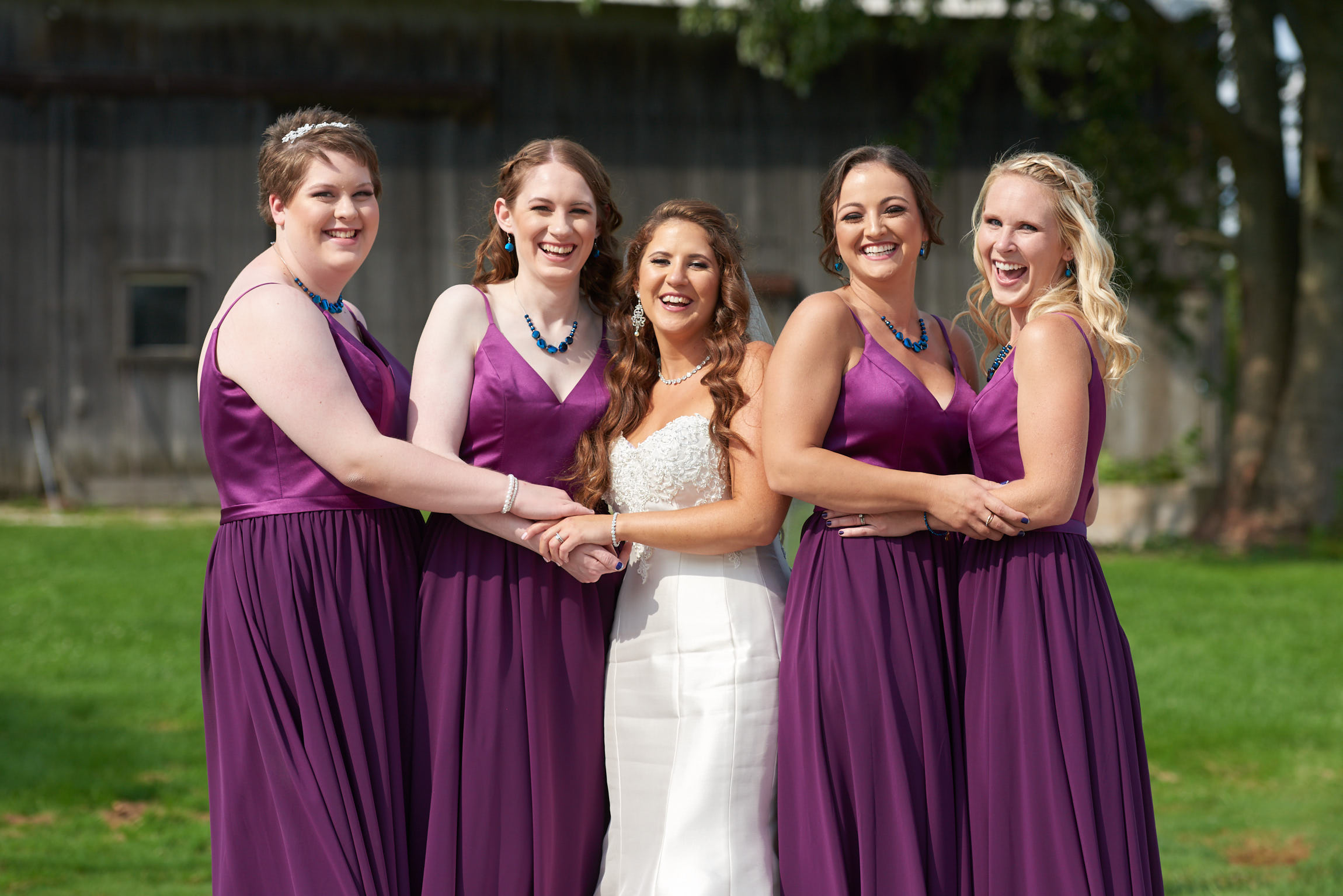 Bridesmaids laughing portrait