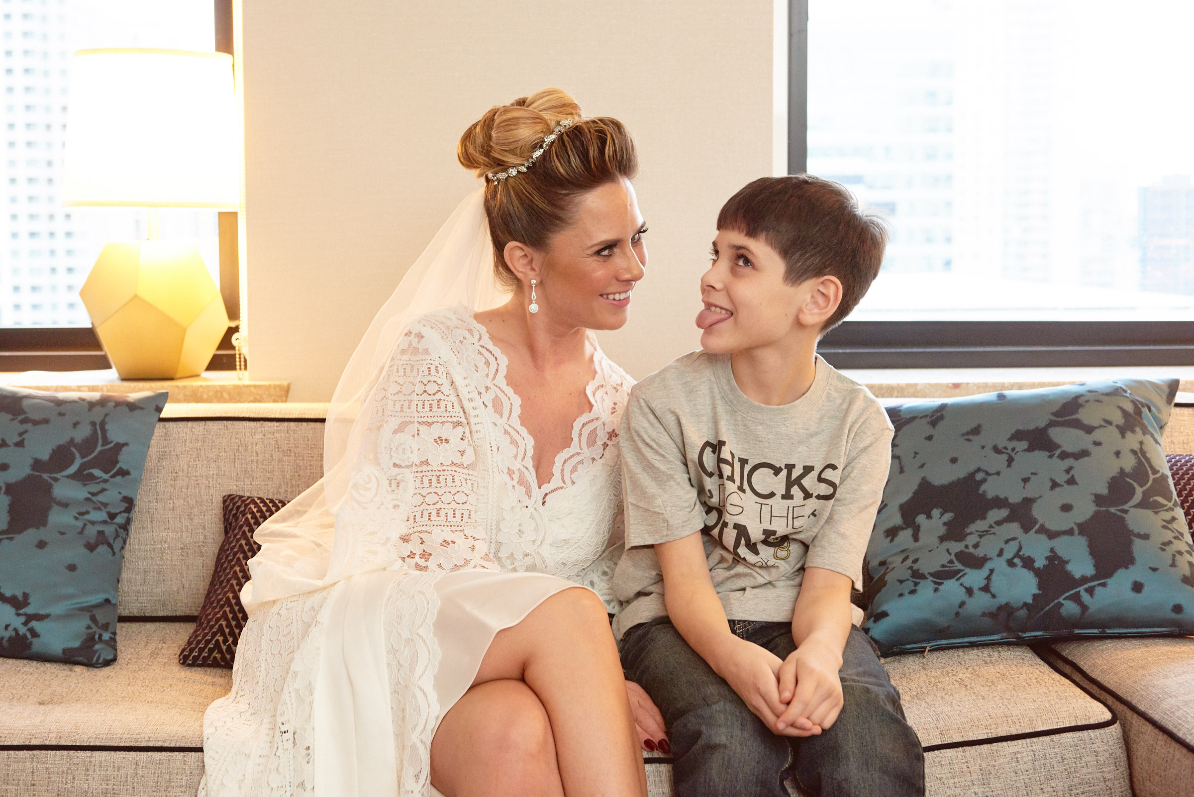 Bride and son making faces