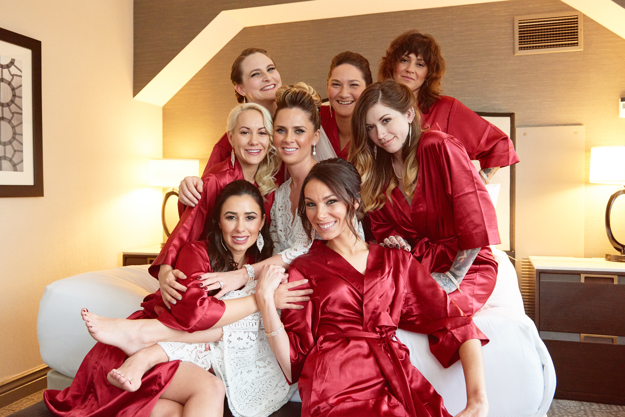 Bridesmaids posing in red robes