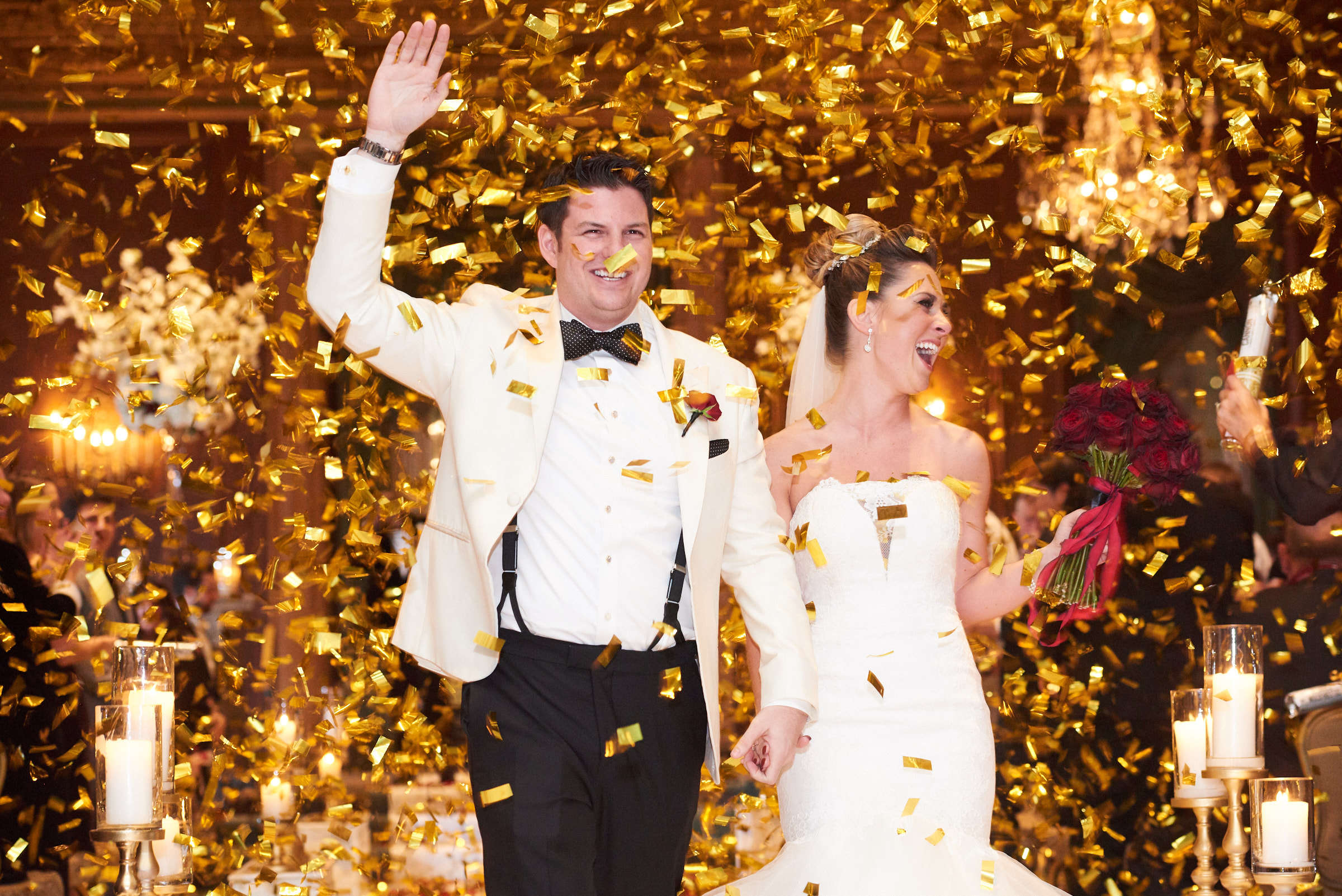 Wedding ceremony with gold confetti poppers